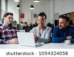 multi ethnic colleagues in a... | Shutterstock . vector #1054324058
