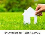 hand hold house against green...   Shutterstock . vector #105432932