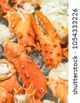 Small photo of alaskan king crab and seafood on ice