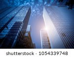 skyscrapers' low angle view in... | Shutterstock . vector #1054339748