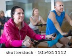 satisfied older men and women... | Shutterstock . vector #1054351112