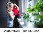 Little Girl Is Watering Flowers ...