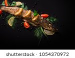 cooked pike with tomato  lemon... | Shutterstock . vector #1054370972