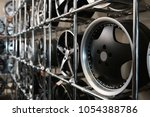 alloy wheels on racks in... | Shutterstock . vector #1054388786