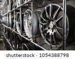 alloy wheels on racks in... | Shutterstock . vector #1054388798