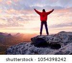 male hiker walking on top of... | Shutterstock . vector #1054398242