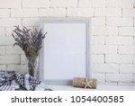 lavender in an antique glass... | Shutterstock . vector #1054400585