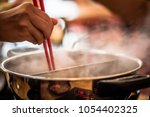 shabu shabu is a japanese...   Shutterstock . vector #1054402325