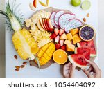 many sliced colorful tropical... | Shutterstock . vector #1054404092