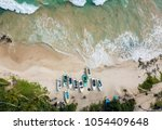beautiful beach with turquoise... | Shutterstock . vector #1054409648