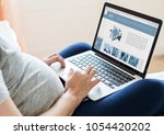 pregnant woman using computer... | Shutterstock . vector #1054420202