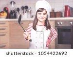 cute little girl chef in the... | Shutterstock . vector #1054422692