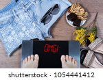 digital scales with female feet ... | Shutterstock . vector #1054441412