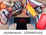 digital scales with female feet ... | Shutterstock . vector #1054441418