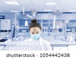female scientist working in the ... | Shutterstock . vector #1054442438