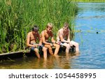 boys  teenagers are resting on... | Shutterstock . vector #1054458995