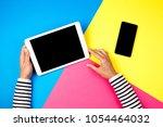 woman's hands with tablet...   Shutterstock . vector #1054464032