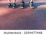 father and son preparing to run ... | Shutterstock . vector #1054477448