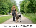 Stock photo happy girl walking with dogs 105448958