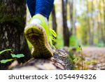 the girl is walking on a log | Shutterstock . vector #1054494326