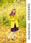 elegant and happy young... | Shutterstock . vector #1054526402