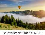 misty dawn in the mountains in...   Shutterstock . vector #1054526702