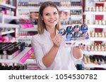 adult female seller showing... | Shutterstock . vector #1054530782