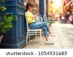 shopper woman buying online on... | Shutterstock . vector #1054531685