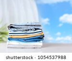 stack cotton clothes on white... | Shutterstock . vector #1054537988