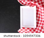 red checkered cloth on...   Shutterstock . vector #1054547336
