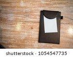 bill folder with white paper | Shutterstock . vector #1054547735