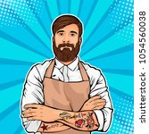 bearded man with tattoo on arms ... | Shutterstock .eps vector #1054560038
