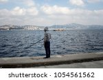 fisherman by bosphorus strait...   Shutterstock . vector #1054561562