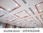 white ceiling with neon lights...