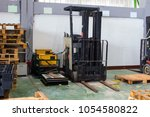electric forklift charge the... | Shutterstock . vector #1054580822