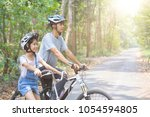 happy father and daughter... | Shutterstock . vector #1054594805