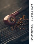 pipe smoking tobacco on a... | Shutterstock . vector #1054614695