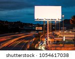 blank billboard at twilight... | Shutterstock . vector #1054617038