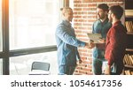 manager of the company welcomes ... | Shutterstock . vector #1054617356