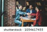 business partners shake hands... | Shutterstock . vector #1054617455