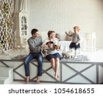 portrait of a happy family and... | Shutterstock . vector #1054618655