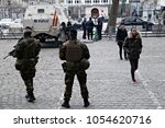Small photo of Belgian soldiers stand guard at the entrance to the courthouse in Brussels, Belgium on Feb 8 2018 for the second day of the trial of prime suspect in the November 2015 Paris attacks Salah Abdeslam
