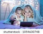 grandmother and granddaughter... | Shutterstock . vector #1054630748