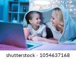 grandmother and granddaughter... | Shutterstock . vector #1054637168