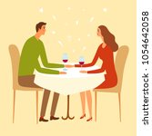 pair sitting in a restaurant... | Shutterstock .eps vector #1054642058