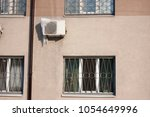 air conditioner with frozen ice ... | Shutterstock . vector #1054649996