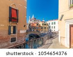 view of canal in venice and... | Shutterstock . vector #1054654376