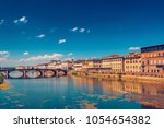 ponte alla carraia bridge over... | Shutterstock . vector #1054654382