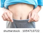 close up stomach of girl on... | Shutterstock . vector #1054713722