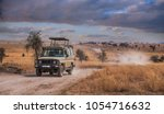 a game drive safari in... | Shutterstock . vector #1054716632